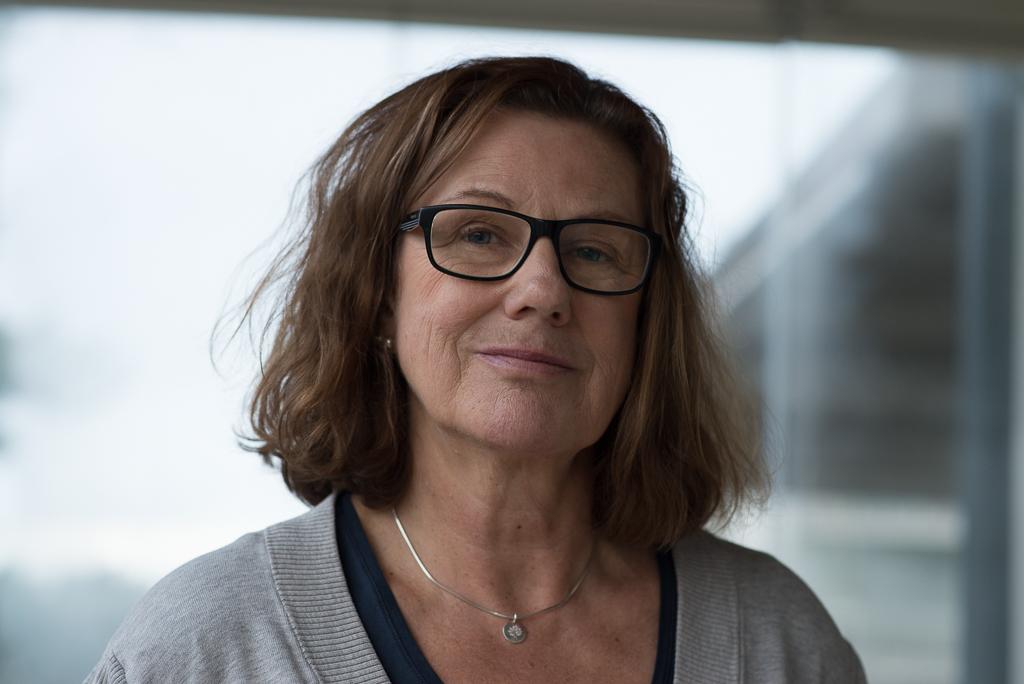 Fotografi av en medelålders kvinna med brunt hår och glasögon. Foto: Britt-Marie Sedvall rs